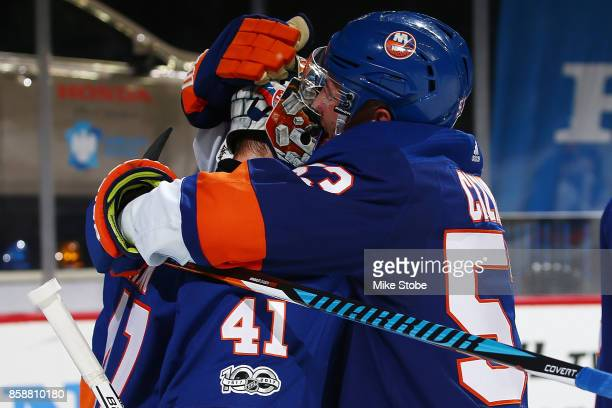 Casey Cizikas of the New York Islanders celebrates defeating the Buffalo Sabres with Jaroslav Halak at Barclays Center on October 7 2017 in New York...