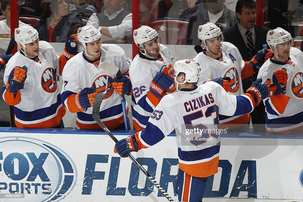 Casey Cizikas #53 of the New York Islanders celebrates his game winning goal against the Florida Panthers with teammates at the BB&T Center on March 16, 2013 in Sunrise, Florida. The Islanders defeated the Panthers 4-3.