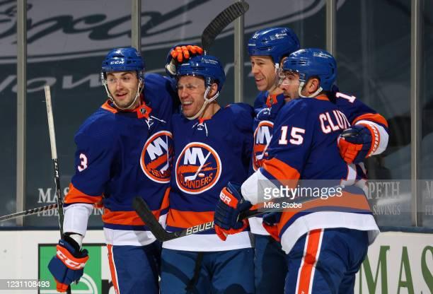 Casey Cizikas of the New York Islanders is congratulated by Adam Pelech, Matt Martin and Cal Clutterbuck after scoring a goal against the Pittsburgh...