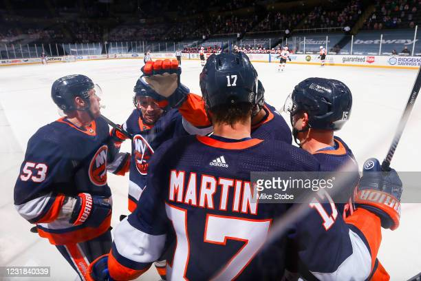 Casey Cizikas of the New York Islanders is congratulated by his teammates after scoring a goal against the Philadelphia Flyers during the first...