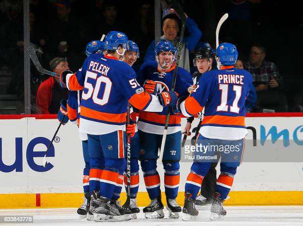 Casey Cizikas of the New York Islanders is congratulated by his teammates after scoring a second period goal against the Carolina Hurricanes at...