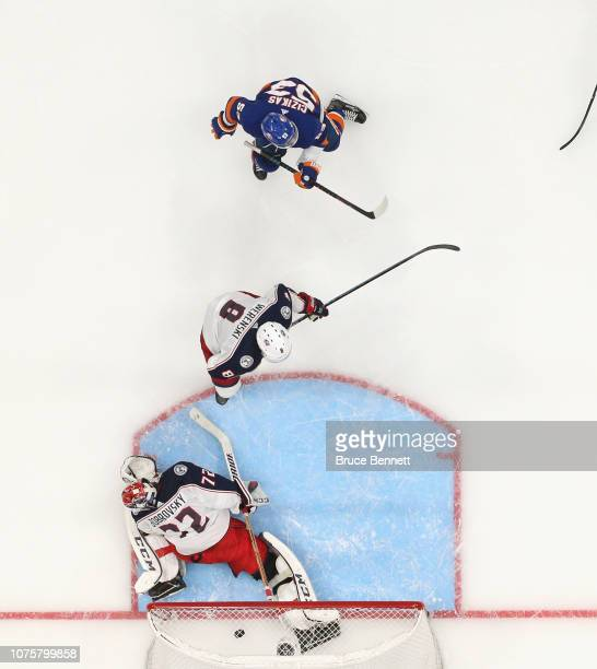Casey Cizikas of the New York Islanders scores the game winning goal at 709 of the third period against Sergei Bobrovsky of the Columbus Blue Jackets...