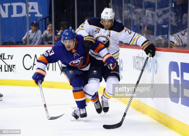 Casey Cizikas of the New York Islanders skates against Kyle Okposo of the Buffalo Sabres at the Barclays Center on October 7 2017 in the Brooklyn...