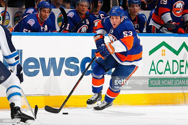 Casey Cizikas of the New York Islanders skates against the Winnipeg Jets at Nassau Veterans Memorial Coliseum on October 28, 2014 in Uniondale, New...