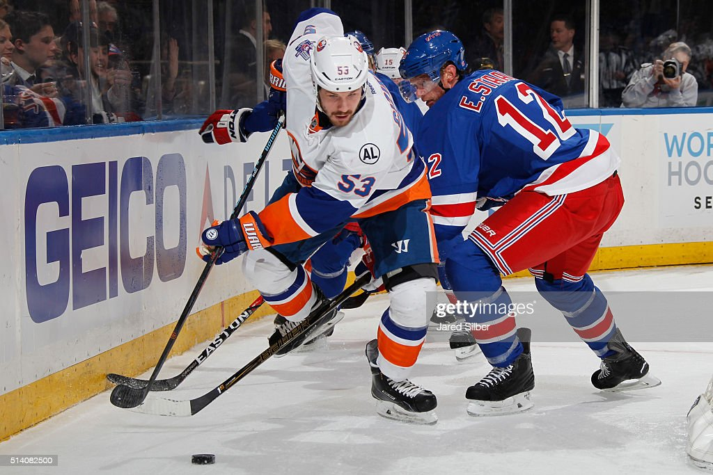 Casey Cizikas #53 of the New York Islanders skates wth the puck against Eric Staal #12 of the New York Rangers at Madison Square Garden on March 6, 2016 in New York City.