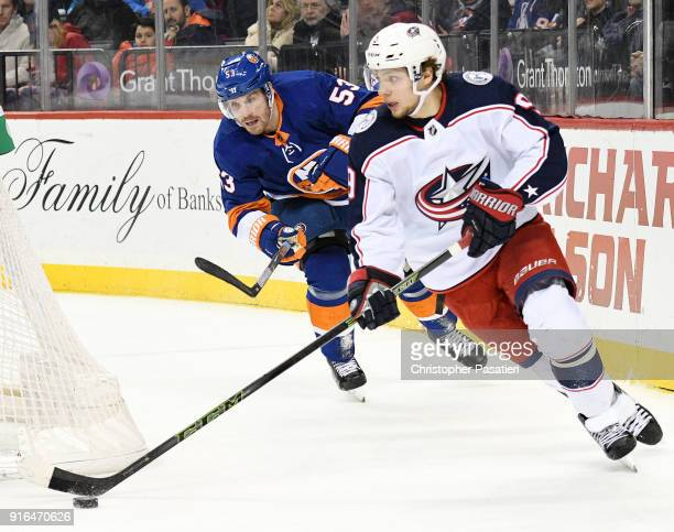 Casey Cizikas of the New York Islanders watches Artemi Panarin of the Columbus Blue Jackets as he skates with the puck during the third period at...