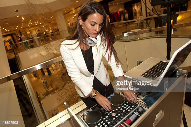 Casey Connor spins at Cookie Johnson And Neiman Marcus Host Girls Night Out on April 18 2013 in Beverly Hills California