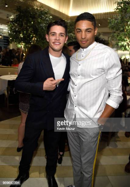 Casey Cott and Daniel Ezra attend The CW Network's 2018 upfront party at Avra Madison Estiatorio on May 17 2018 in New York City