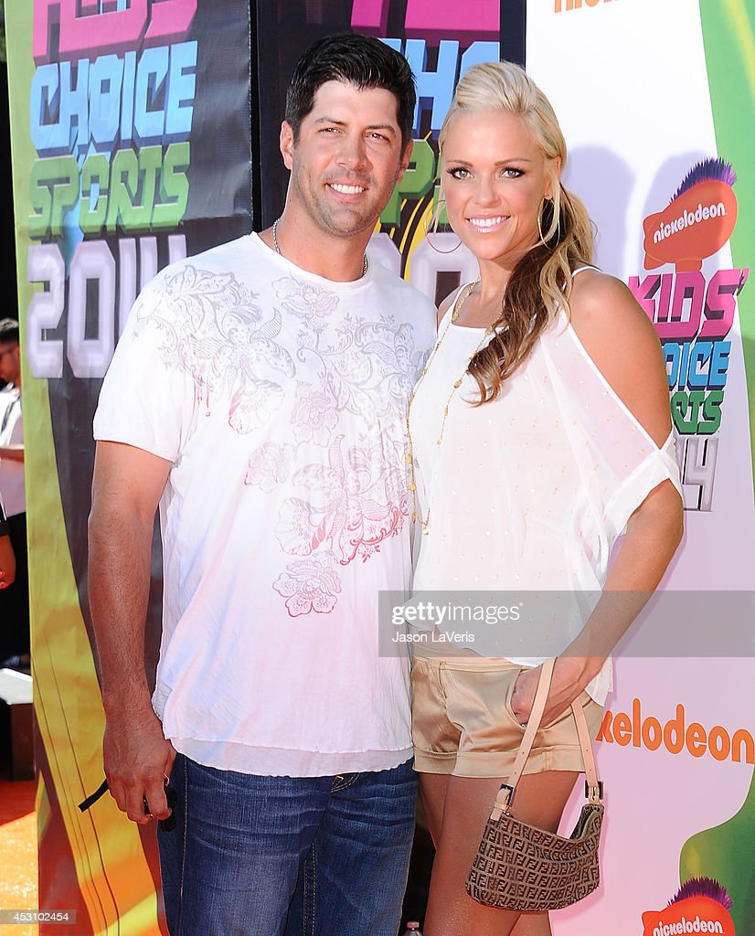 Casey Daigle and Jennie Finch attend the 2014 Nickelodeon Kids' Choice Sports Awards at Pauley Pavilion on July 17, 2014 in Los Angeles, California.