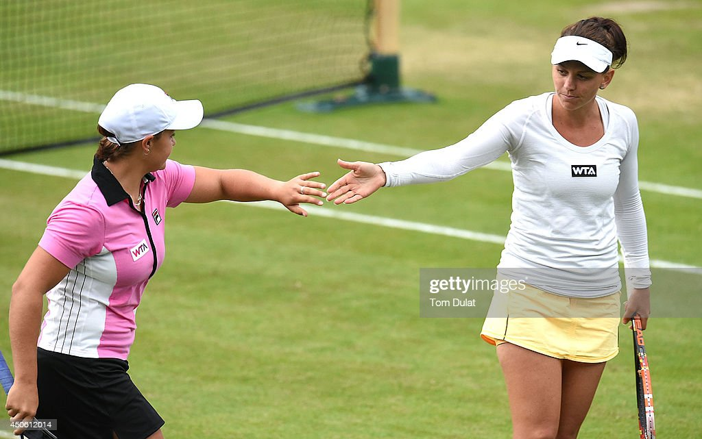 Casey Dellacqua (R) and Ashleigh Barty (L) of Australia celebrate during their match against Caroline Garcia of France and Shuai Zhang of China on day six of the Aegon Classic at Edgbaston Priory Club on June 13, 2014 in Birmingham, England.