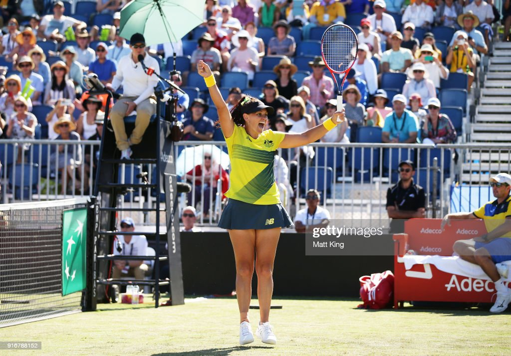Casey Dellacqua of Australia celebrates victory partnering with Ashleigh Barty in the doubles match against Lyudmyla Kichenok and Nadiia Kichenok of Ukraine during the Fed Cup tie between Australia and the Ukraine at the Canberra Tennis Centre on February 11, 2018 in Canberra, Australia.