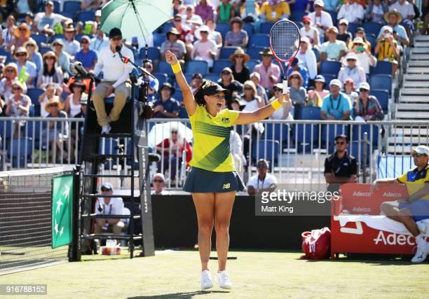 Casey Dellacqua of Australia celebrates victory partnering with Ashleigh Barty in the doubles match against Lyudmyla Kichenok and Nadiia Kichenok of...
