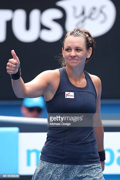 Casey Dellacqua of Australia celebrates winning her first round match against Yvonne Meusburger of Austria during day two of the 2015 Australian Open...