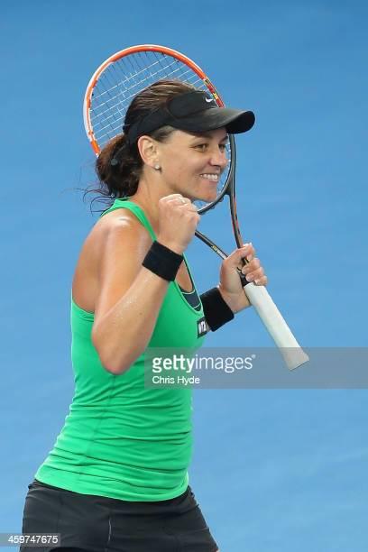 Casey Dellacqua of Australia celebrates winning her match against Galina Voskoboeva of Kazakhstan during day two of the 2014 Brisbane International...