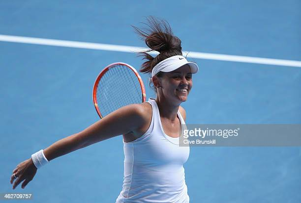 Casey Dellacqua of Australia celebrates winning her second round match against Kirsten Flipkens of Belgium during day three of the 2014 Australian...