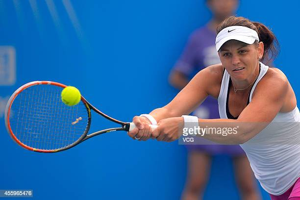 Casey Dellacqua of Australia competes with Anastasia Pavlyuchenkova of Russia during day three of the 2014 Dongfeng Motor Wuhan Open at Optics Valley...