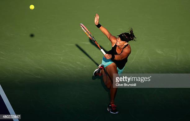 Casey Dellacqua of Australia in action against Venus Williams of the United States during their third round match during day 7 at the Sony Open at...
