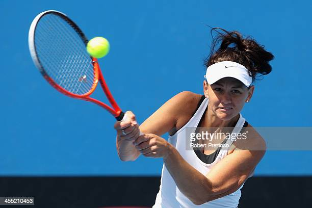 Casey Dellacqua of Australia plays a backhand in her quaterfinals match against Monique Adamczak of Australia in the Australian Open 2014 Qualifying...