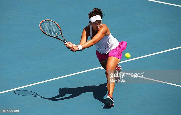 Casey Dellacqua of Australia plays a backhand in her singles match against Irina Khromacheva of Russia during the Fed Cup tie between Australia and...