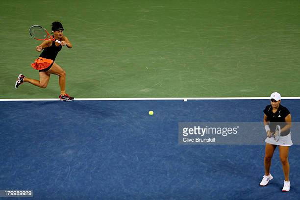 Casey Dellacqua of Australia plays a forehand behind her partner Ashleigh Barty during their women's doubles final match against Andrea Hlavackova...