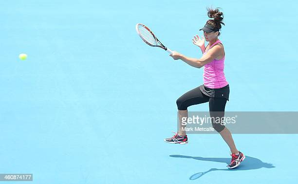 Casey Dellacqua of Australia plays a forehand in her first round match against Alison Van Uytvanck of Belgium during day two of the Moorilla Hobart...