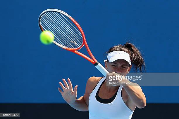 Casey Dellacqua of Australia plays a forehand in her quaterfinals match against Monique Adamczak of Australia in the Australian Open 2014 Qualifying...