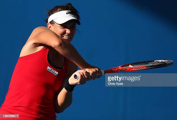 Casey Dellacqua of Australia plays a shot during her doubles match partned with Ashleigh Barty during day four of the 2012 Brisbane International at...