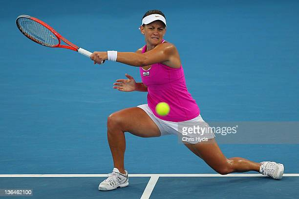 Casey Dellacqua of Australia plays a shot in her double semi final match partnered with Ashleigh Barty during day six of the 2012 Brisbane...