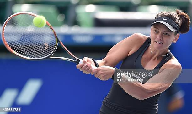 Casey Dellacqua of Australia returns a shot against Marina Erakovic of New Zealand during their women's singles second round match at the Pan Pacific...