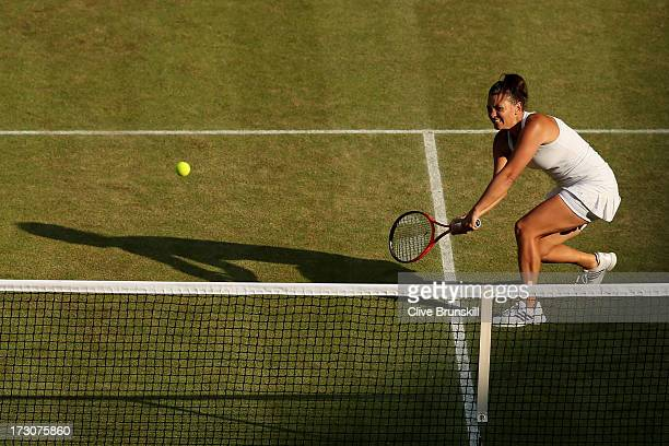 Casey Dellacqua of Australia volleys partnering Ashleigh Barty of Australia during the Ladies' Doubles Final against SuWei Hsieh of Chinese Taipei...