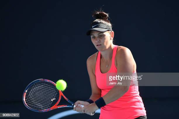 Casey Dellacqua plays a backhand in her first round women's doubles match with Ashleigh Barty of Australia against Elise Mertens of Belgium and Demi...