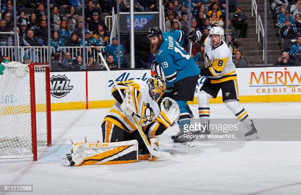 Casey DeSmith and Brian Dumoulin of the Pittsburgh Penguins defend the net against Joe Thornton of the San Jose Sharks at SAP Center on January 20...