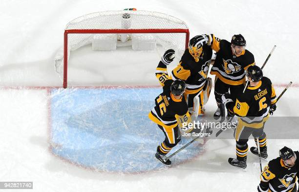 Casey DeSmith of the Pittsburgh Penguins celebrates with teammates after a 40 win against the Ottawa Senators at PPG Paints Arena on April 6 2018 in...