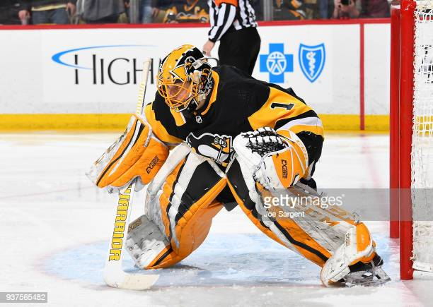Casey DeSmith of the Pittsburgh Penguins defends the net against the Montreal Canadiens at PPG Paints Arena on March 21 2018 in Pittsburgh...