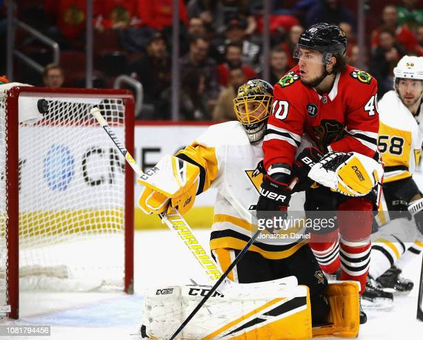 Casey DeSmith of the Pittsburgh Penguins knocks the puck away on a shot by John Hayden of the Chicago Blackhawks at the United Center on December 12...