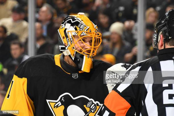 Casey DeSmith of the Pittsburgh Penguins looks on against the against the Montreal Canadiens at PPG Paints Arena on March 21 2018 in Pittsburgh...