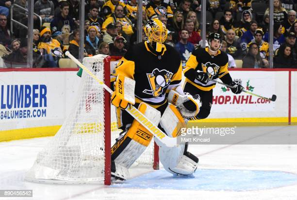 Casey DeSmith of the Pittsburgh Penguins looks on during a game against the Toronto Maple Leafs at PPG PAINTS Arena on December 9 2017 in Pittsburgh...
