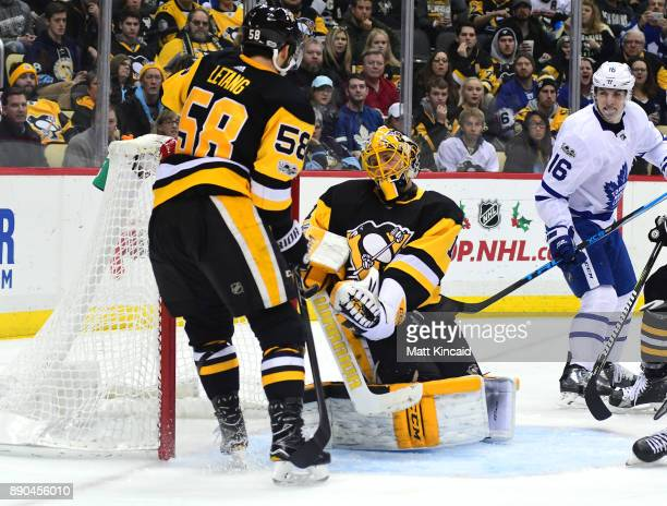 Casey DeSmith of the Pittsburgh Penguins makes a save against the Toronto Maple Leafs at PPG PAINTS Arena on December 9 2017 in Pittsburgh...