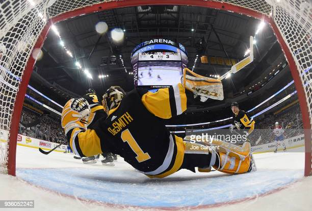 Casey DeSmith of the Pittsburgh Penguins makes a save during the third period against the Montreal Canadiens at PPG Paints Arena on March 21 2018 in...