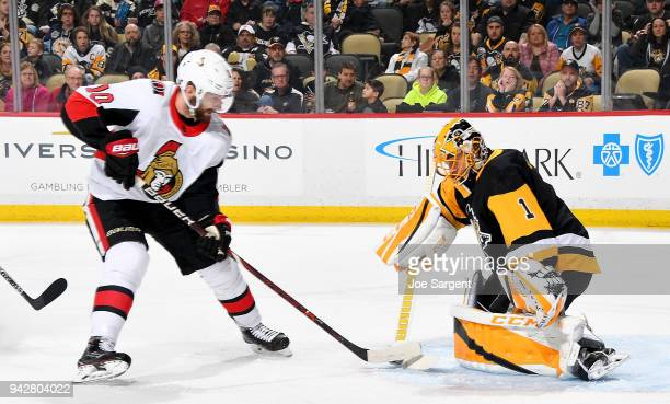 Casey DeSmith of the Pittsburgh Penguins makes a save on Tom Pyatt of the Ottawa Senators at PPG Paints Arena on April 6 2018 in Pittsburgh...