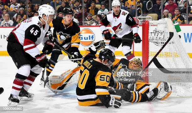 Casey DeSmith of the Pittsburgh Penguins protects the net against the Arizona Coyotes at PPG Paints Arena on November 10 2018 in Pittsburgh...