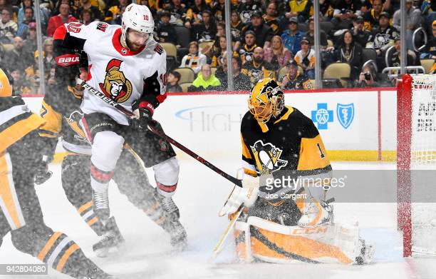 Casey DeSmith of the Pittsburgh Penguins protects the net against Tom Pyatt of the Ottawa Senators at PPG Paints Arena on April 6 2018 in Pittsburgh...