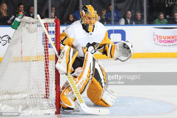 Casey DeSmith of the Pittsburgh Penguins tends the net against the New York Rangers at Madison Square Garden on March 14 2018 in New York City The...