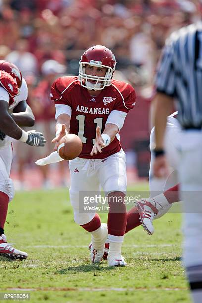 Casey Dick of the Arkansas Razorbacks pitches the ball to a running back against the Alabama Crimson Tide at Donald W Reynolds Stadium on September...