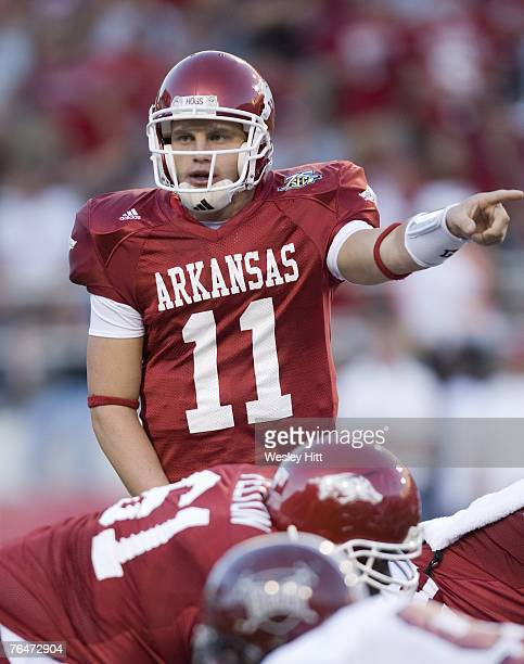 Casey Dick of the Arkansas Razorbacks signals to a wide receiver during a game against the Troy Trojans at Donald W Reynolds Stadium September 1 2007...