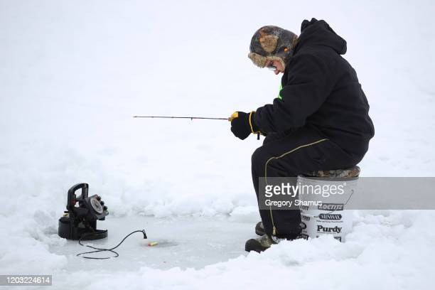 Casey Dockter from Brainerd Minnesota fishes during the Brainerd Jaycees Ice Fishing Extravaganza on January 25, 2020 in Brainerd, Minnesota.