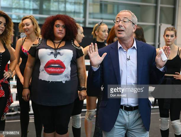 Casey Donovan looks on as Ben Elton talks to the media during rehearsals for We Will Rock You at ABC Studios on April 7 2016 in Sydney Australia
