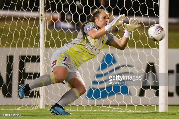 Casey Dumont of the Victory blocks a penalty kick from Tameka Yallop of the Roar during the round two W-League match the between Brisbane Roar and...