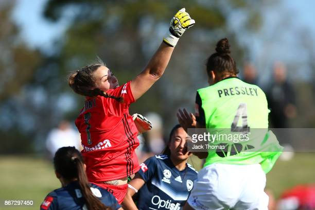 Casey Dumont of the Victory punches the ball away during the round one W-League match between Melbourne Victory and Canberra United at Epping Stadium...