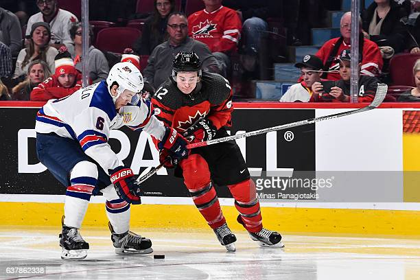 Casey Fitzgerald of Team United States and Julien Gauthier of Team Canada battle for the puck during the 2017 IIHF World Junior Championship gold...